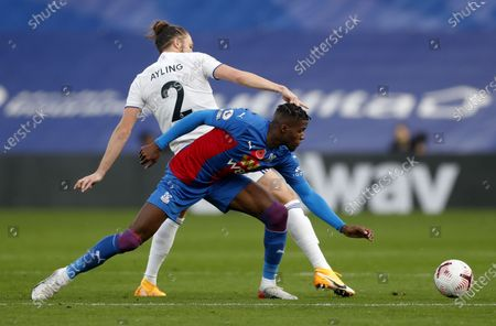Wilfried Zaha (front) of Palace in action against Luke Ayling (back) of Leeds during the English Premier League soccer match between Crystal Palace and Leeds United at Selhurst Park in London, Britain, 07 November 2020.