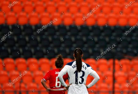 Tottenham Hotspur's Alex Morgan, right, waits for a free kick to be taken marked by Reading's Angharad James during the English Women's Super League soccer match between Tottenham Hotspur and Reading at the Hive stadium in London . Morgan came on as a 69th minute substitute, the game ended in a 1-1 draw