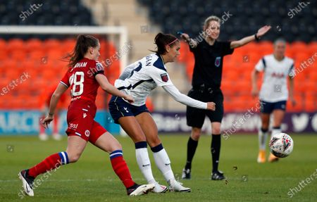 Tottenham Hotspur's Alex Morgan, right, plays the ball forward as Reading's Lily Woodham challenges during the English Women's Super League soccer match between Tottenham Hotspur and Reading at the Hive stadium in London . Morgan came on as a 69th minute substitute, the game ended in a 1-1 draw