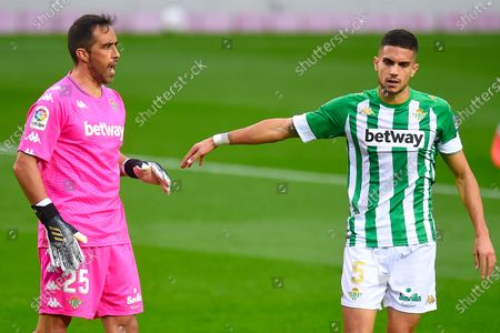 Marc Bartra of Real Betis congratulates his teammate Claudio Bravo after stoping the penalty