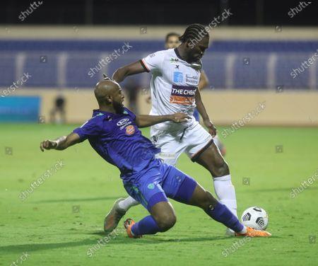 Al-Fateh player Ali Al-Hassan (L) in action against Al Shabab player Makhete Diop during the Saudi Professional League soccer match between Al Fateh and Al Shabab at Prince Abdullah bin Jalawi Sports City Stadium, Al-Hasa, 07 November 2020.