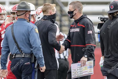 Stock Image of Arkansas State head coach Blake Anderson, left, greets Louisiana-Lafayette head coach Billy Napier after Louisiana's victory during an NCAA football game on in Lafayette, La