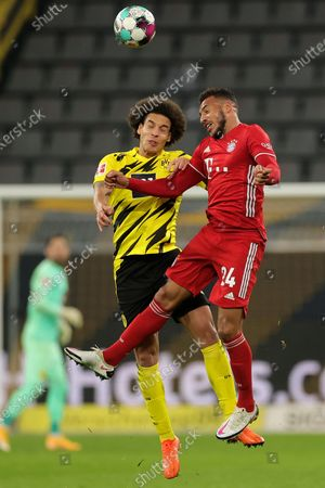 Bayern's Corentin Tolisso (R) in action against Dortmund's Axel Witsel (L) during the German Bundesliga soccer match between Borussia Dortmund and Bayern Muenchen in Dortmund, Germany, 07 November 2020.