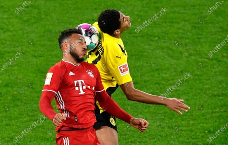 Stock Picture of Bayern's Corentin Tolisso, left, and Dortmund's Jude Bellingham challenge for the ball during the German Bundesliga soccer match between Borussia Dortmund and Bayern Munich in Dortmund, Germany