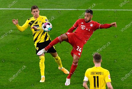 Stock Image of Dortmund's Thorgan Hazard, left, and Bayern's Corentin Tolisso challenge for the ball during the German Bundesliga soccer match between Borussia Dortmund and Bayern Munich in Dortmund, Germany