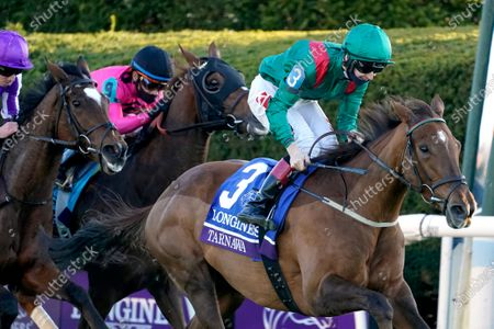 Colin Keane (3) rides Tarnawa to win the Breeders' Cup Turf horse race at Keeneland Race Course, in Lexington, Ky