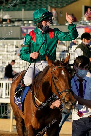 Colin Keane gives a thumbs up after riding Tarnawa to win the Breeders' Cup Turf horse race at Keeneland Race Course, in Lexington, Ky