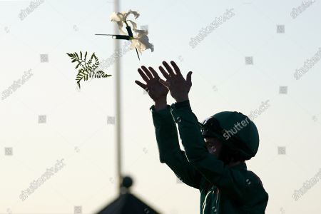 Colin Keane tosses flowers into the air after riding Tarnawa to win the Breeders' Cup Turf horse race at Keeneland Race Course, in Lexington, Ky