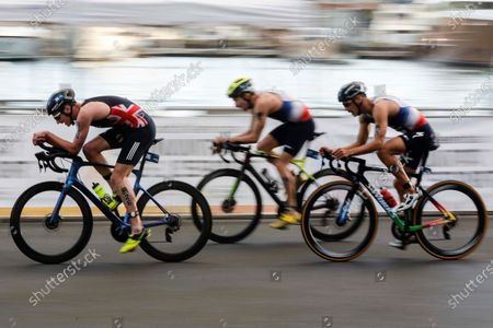 French Vincent Luis (R), British Alistair Brownlee (L), and Belgium Jelle Geens (C), in action during the cycling portion of the ITU Triathlon World Cup held in Valencia, eastern Spain, 07 November 2020.
