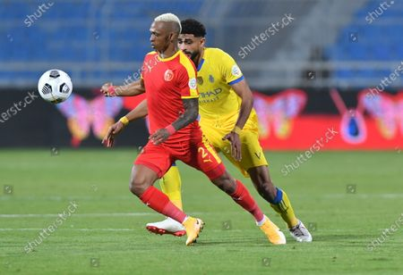 Al Quadisiya player Charles Andriamasinoro (L) in action during the Saudi Professional League soccer match between Al Nassr and Al Quadisiya at Prince Faisal bin Fahd Stadium, in Riyadh, Saudi Arabia, 07 November 2020.