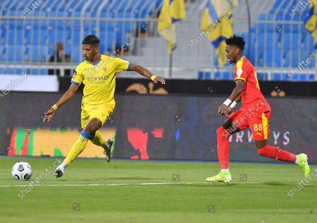 Al Nassr player Raed Al-Ghamdi (L) in action  against Al Quadisiya player Hamad Al Tuhayfan during the Saudi Professional League soccer match between Al Nassr and Al Quadisiya at Prince Faisal bin Fahd Stadium, in Riyadh, Saudi Arabia, 07 November 2020.