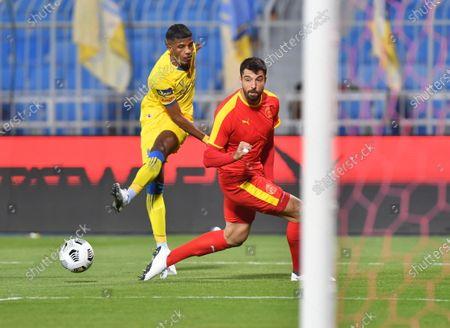Al Nassr player Raed Al-Ghamdi (L) in action  against Al Quadisiya player Uro Vitas during the Saudi Professional League soccer match between Al Nassr and Al Quadisiya at Prince Faisal bin Fahd Stadium, in Riyadh, Saudi Arabia, 07 November 2020.