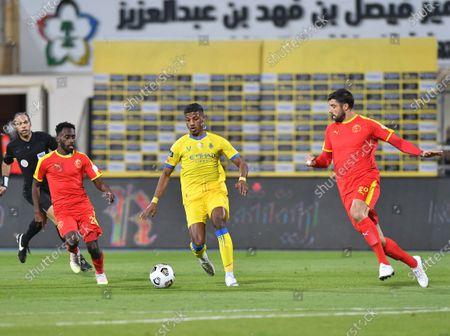Al Nassr player Raed Al-Ghamdi (C) in action against Al Quadisiya player Uro Vitas (R) and Hassan Abu Sharara (L) during the Saudi Professional League soccer match between Al Nassr and Al Quadisiya at Prince Faisal bin Fahd Stadium, in Riyadh, Saudi Arabia, 07 November 2020.