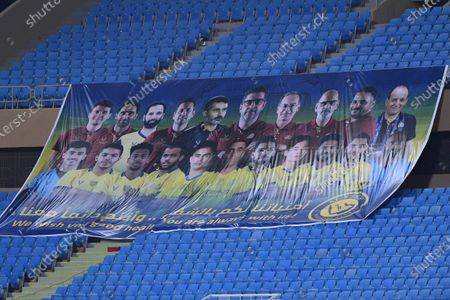 A banner featuring players and officials of Al Nassr who suffer the Covid-19 is seen on empty seats during the Saudi Professional League soccer match between Al Nassr and Al Quadisiya at Prince Faisal bin Fahd Stadium, in Riyadh, Saudi Arabia, 07 November 2020.