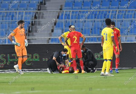 Al Quadisiya player Stanley Ohawuchi receives medical assistance after suffering an injury during the Saudi Professional League soccer match between Al Nassr and Al Quadisiya at Prince Faisal bin Fahd Stadium, in Riyadh, Saudi Arabia, 07 November 2020.