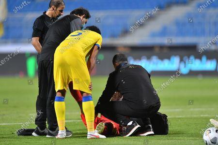 Al Quadisiya player receives medical assistance after suffering an injury during the Saudi Professional League soccer match between Al Nassr and Al Quadisiya at Prince Faisal bin Fahd Stadium, in Riyadh, Saudi Arabia, 07 November 2020.