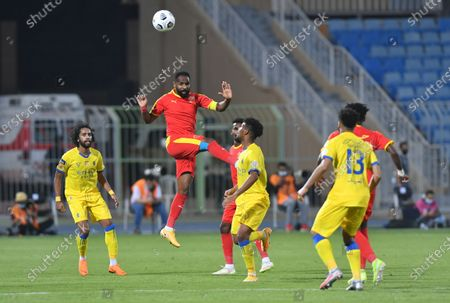 Stock Picture of Al Quadisiya player Naif Hazazi (C) jumps for the ball during the Saudi Professional League soccer match between Al Nassr and Al Quadisiya at Prince Faisal bin Fahd Stadium, in Riyadh, Saudi Arabia, 07 November 2020.