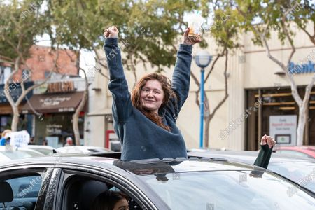 Stock Image of Emma Kenney celebrates in West Hollywood after Joe Biden is declared the president-elect