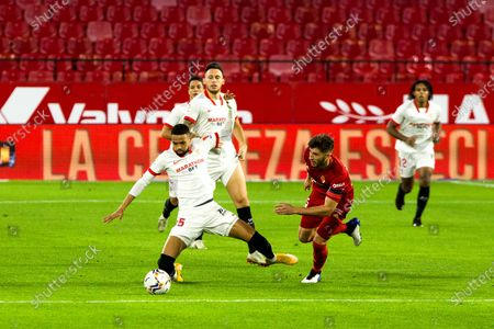 Youssef En-Nesyri of Sevilla and Oier of Osasuna during LaLiga, football match played between Sevilla Futbol Club and Club Atletico Osasuna at Ramon Sanchez Pizjuan Stadium on November 7, 2020 in Sevilla, Spain.
