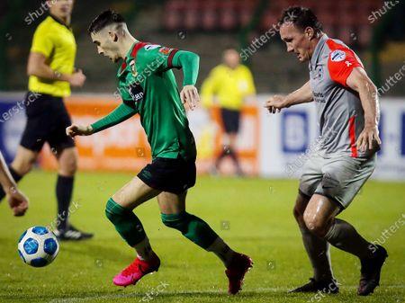 Glentoran vs Larne. Glentoran's Jay Donnelly with Larne's Albert Watson