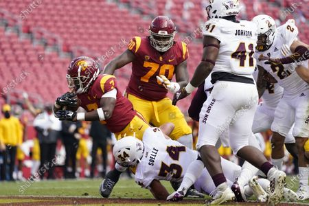 Southern California running back Stephen Carr (7) crosses the goal line for a touchdown against Arizona State during the first half of an NCAA college football game, in Los Angeles