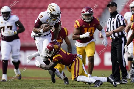 Stock Picture of Arizona State quarterback Jayden Daniels (5) is tackled by Southern California safety Greg Johnson (9) during the second half of an NCAA college football game, in Los Angeles