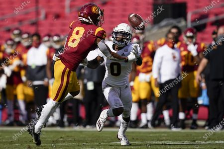 Stock Photo of Southern California wide receiver Amon-Ra St. Brown (8) and Arizona State defensive back Jack Jones (0) reach for an incomplete pass during the first half of an NCAA college football game, in Los Angeles
