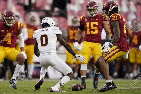 Arizona State defensive back Jack Jones (0) fumbles the ball on a punt return against Southern California during the first half of an NCAA college football game, in Los Angeles