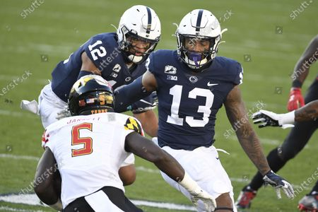 Penn State linebackers Ellis Brooks (13) and Brandon Smith (12) pursue Maryland wide receiver Rakim Jarrett (5) during an NCAA college football game in State College, Pa., on