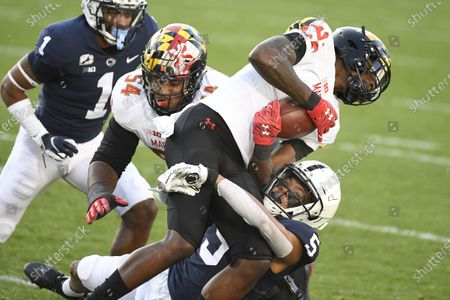 Penn State cornerback Tariq Castro-Fields (5) tackles Maryland wide receiver Darryl Jones (21) during an NCAA college football game in State College, Pa., on