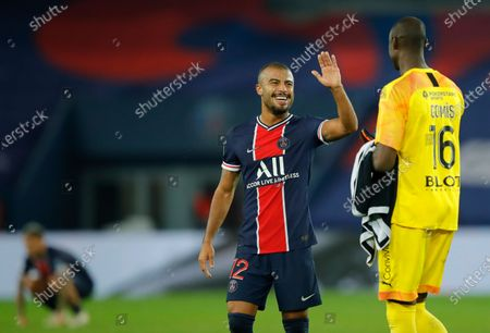 PSG's Rafinha, center, greets Rennes' goalkeeper Alfred Gomis after the French League One soccer match between Paris Saint-Germain and Rennes at the Parc des Princes in Paris, France