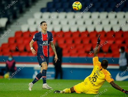 PSG's Angel Di Maria scores his side's second goal past Rennes' goalkeeper Alfred Gomis during the French League One soccer match between Paris Saint-Germain and Rennes at the Parc des Princes in Paris, France