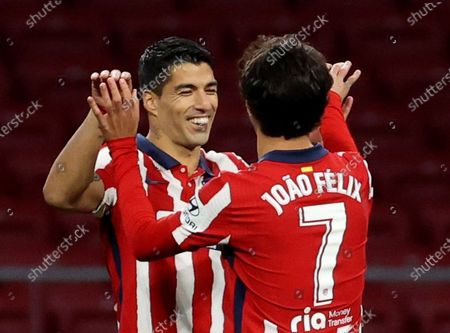 Atletico Madrid's striker Luis Suarez (L) celebrates with teammate Joao Felix (R) after scoring the 3-0 goal during the Spanish LaLiga soccer match between Atletico Madrid and Cadiz CF held at Wanda Metropolitano stadium in Madrid, central Spain, 07 November 2020.
