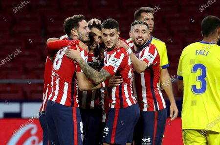 Atletico Madrid's striker Luis Suarez (2-L) celebrates with teammates after scoring the 3-0 goal during the Spanish LaLiga soccer match between Atletico Madrid and Cadiz CF held at Wanda Metropolitano stadium in Madrid, central Spain, 07 November 2020.