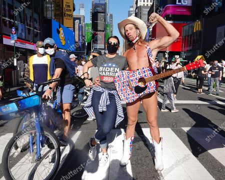 Naked Cowboy celebrates in Times Square the news that Joe Biden will be the 46th President of The United States.