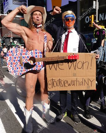 Artist and Activist Tootsie Warhol and Naked Cowboy celebrate Joe Biden as the next President of the United States of America in Times Square