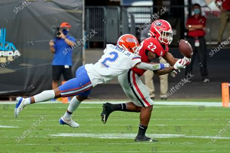 Florida defensive back Brad Stewart Jr. (2) breaks up a pass intended for Georgia running back Kendall Milton (22) during the first half of an NCAA college football game, in Jacksonville, Fla