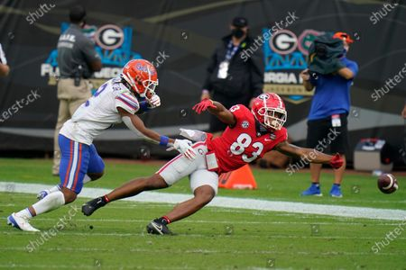 Georgia wide receiver Kaustov Chakrabarti (83) can't make the catch on a pass play as Florida defensive back Brad Stewart Jr., left, defends during the first half of an NCAA college football game, in Jacksonville, Fla