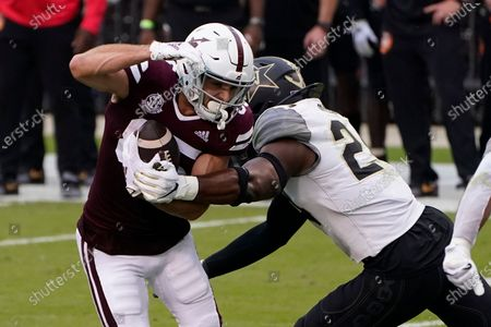 Mississippi State wide receiver Austin Williams (85) catches a pass in front of Vanderbilt linebacker Alston Orji (24) during the second half of an NCAA college football game in Starkville, Miss