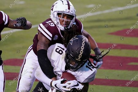 Stock Picture of Vanderbilt wide receiver Chris Pierce Jr. (19) holds on to a 2-yard touchdown pass reception as Mississippi State safety Collin Duncan (19) tries to strip him of the ball during the second half of an NCAA college football game in Starkville, Miss