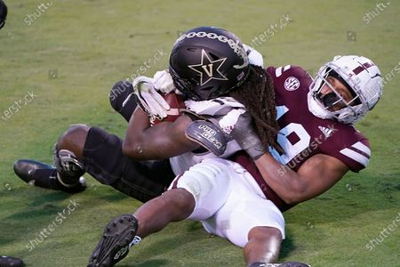 Vanderbilt wide receiver Chris Pierce Jr. (19) holds on to a 2-yard touchdown pass reception as Mississippi State safety Collin Duncan (19) tries to wrestle the ball from him during the second half of an NCAA college football game in Starkville, Miss