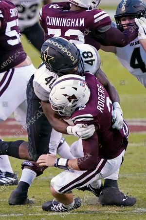 Mississippi State quarterback Will Rogers (2) is sacked by Vanderbilt linebacker Andre Mintze (48) during the second half of an NCAA college football game in Starkville, Miss