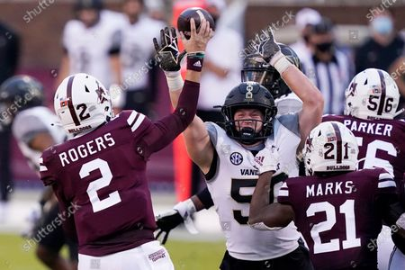 Mississippi State quarterback Will Rogers (2) passes over a rush by Vanderbilt linebacker Ethan Barr (50) during the second half of an NCAA college football game in Starkville, Miss