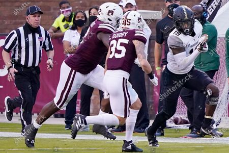 Vanderbilt wide receiver Chris Pierce Jr. (19) tries to elude a tackle by Mississippi State defenders, including safety Landon Guidry (35), during the second half of an NCAA college football game in Starkville, Miss