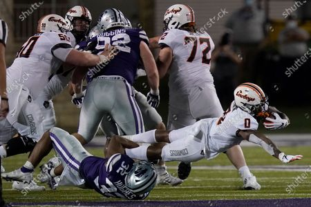 Stock Photo of Oklahoma State running back LD Brown (0) is tackled by Kansas State linebacker Justin Hughes (32) during the second half of an NCAA college football game in Manhattan, Kan