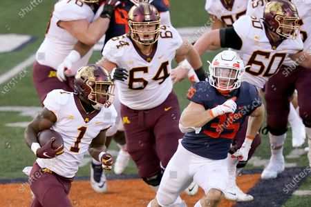 Minnesota running back Cam Wiley (1) carries the ball during the first half of an NCAA college football game against Illinois, in Champaign, Ill