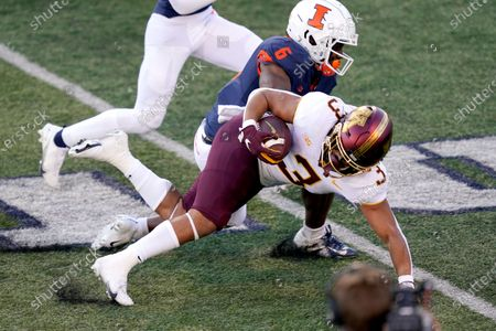 Stock Picture of Minnesota running back Treyson Potts (3) is tackled by Illinois defensive back Tony Adams during the first half of an NCAA college football game, in Champaign, Ill