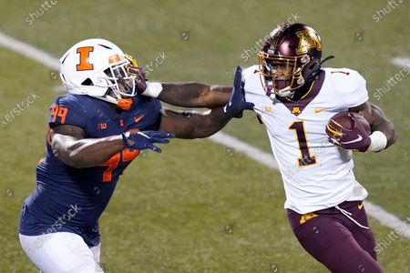 Minnesota running back Cam Wiley (1) stiff arms Illinois defensive lineman Owen Carney Jr. during the second half of an NCAA college football game, in Champaign, Ill. Minnesota won 41-14