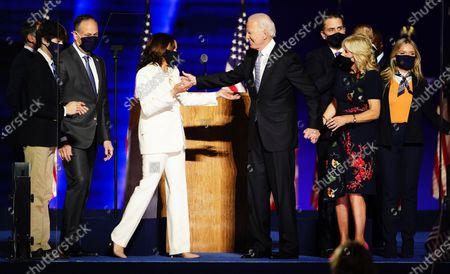President-elect Joe Biden and Dr. Jill Biden (R) with Vice President Elect Kamala Harris and Doug Emhoff are joined by family members wave after Biden delivered his victory address after being declared the winner in the 2020 presidential election in Wilmington, Delaware, USA, 07 November 2020. Biden defeated incumbent US President Donald J. Trump.
