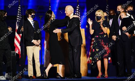 President-elect Joe Biden and Dr. Jill Biden (R) with Vice President Elect Kamala Harris and Doug Emhoff are joined by family memebrs wave after Biden delivered his victory address after being declared the winner in the 2020 presidential election in Wilmington, Delaware, USA, 07 November 2020. Biden defeated incumbent US President Donald J. Trump.